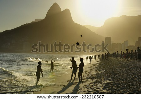 People playing soccer at sunset, Ipanema Beach, the world famous beach, in Rio de Janeiro, Brazil