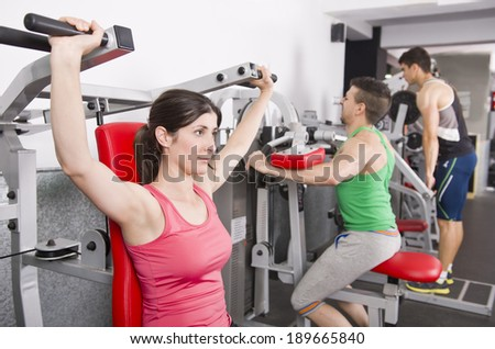 People posing in gym room ready for fitness exercises - stock photo