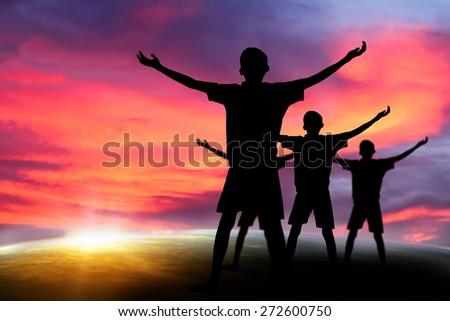 people  praying at the sunset. Elements of this image furnished by NASA