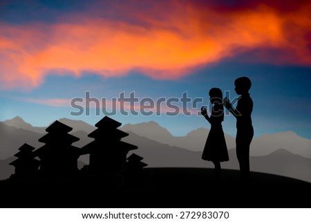 people  praying at the sunset,Pray for the people of Nepal - stock photo