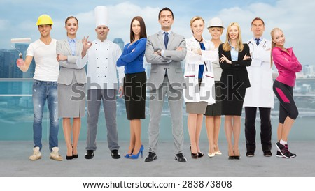people, profession, qualification, employment and success concept - happy businessman with group of professional workers over city background - stock photo