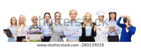 people, profession, qualification, employment and success concept - happy businesswoman over group of professional workers - stock photo