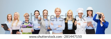 people, profession, qualification, employment and success concept - happy businesswoman with group of professional workers over blue background - stock photo