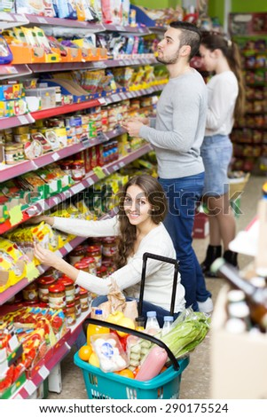 People purchasing a food for week in the supermarket  - stock photo
