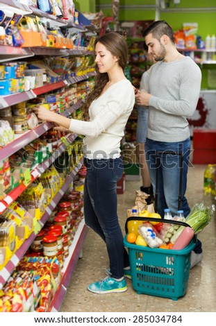 People purchasing food for week at the supermarket  - stock photo