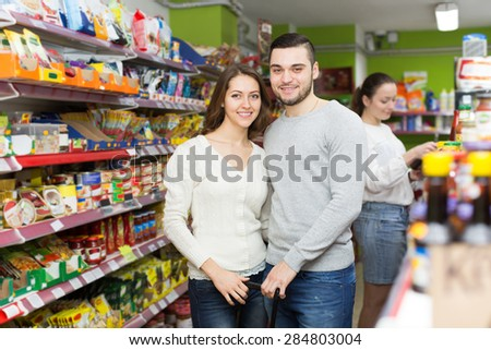 People purchasing food for week in supermarket  - stock photo