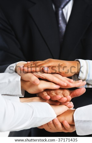 People put their hand on top of each other - stock photo