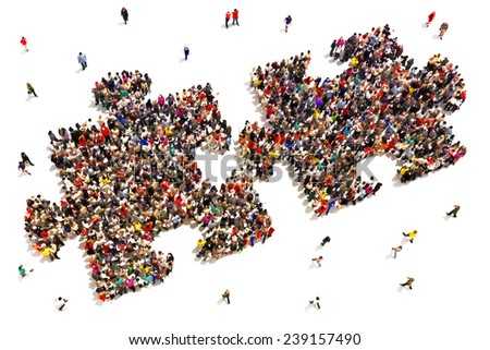 People putting the pieces together concept . Large group of people in the shape of two puzzle pieces on a white background. - stock photo