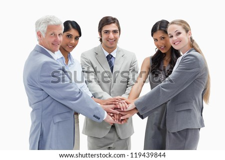 People putting their hands on each others against white background