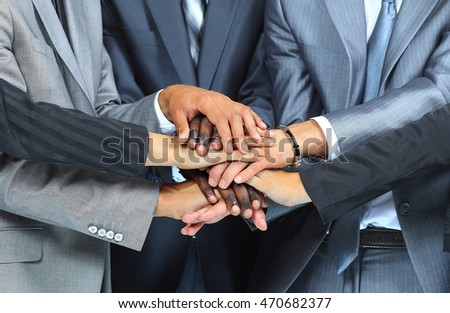 people putting their hands together, focus on hands