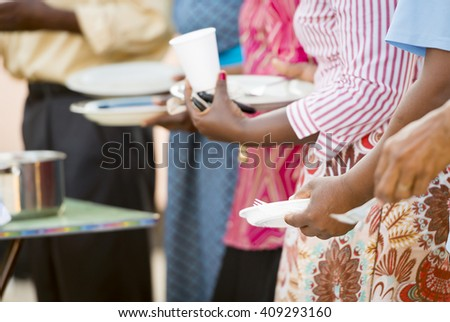 People queue for food to be handed out in Africa - stock photo