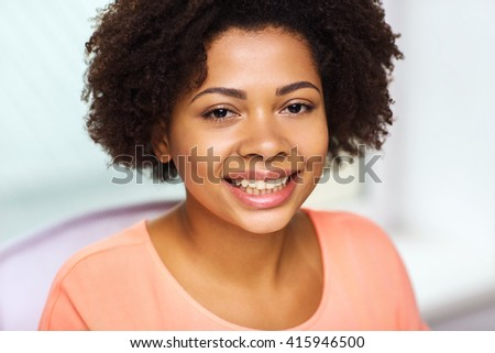 people, race, ethnicity and portrait concept - happy african american young woman face