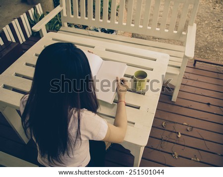 People reading books on the table ,vintage - stock photo