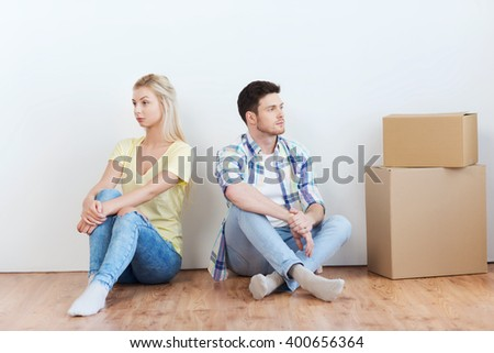 people, relationship difficulties, divorce, conflict and family concept - unhappy couple having argument or break up at home - stock photo