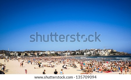 people relaxing at bondi beach on christmas day - stock photo