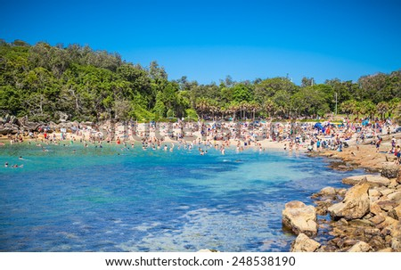 People relaxing on beautiful sandy Shelly beach in Manly, Sydney, Australia. - stock photo