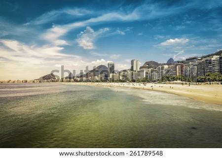 People relaxing on Copacabana Beach in Rio de Janeiro, Brazil - stock photo