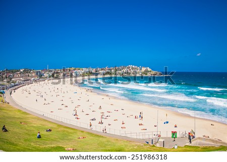 People relaxing on the Bondi beach in Sydney, Australia. Bondi beach is one of the most famous beach in the world.  - stock photo