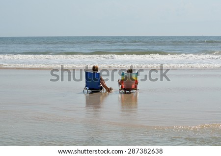 People relaxing on the ocean surf Florida, USA. - stock photo