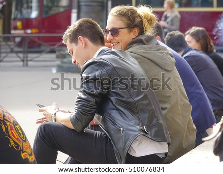 People relaxing on the steps of Paris Opera - PARIS / FRANCE - SEPTEMBER 25, 2016
