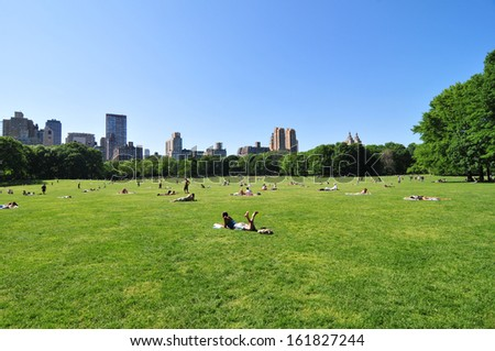 People resting at Central Park, New York City, USA - stock photo