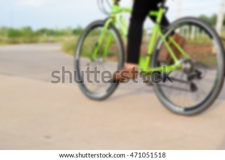 People ride bicycle for healthy lifestyle fun concept, Blurred image for background