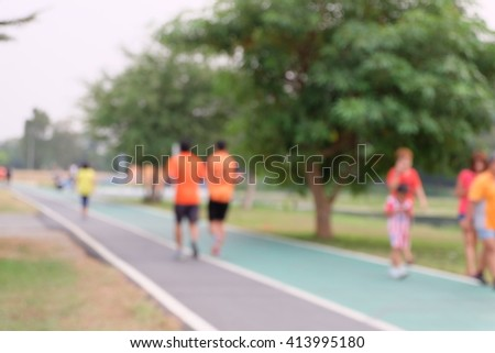 People run on street in Park ,blurred background - stock photo