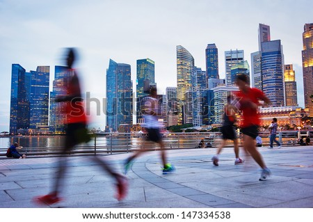 People runing in the evening in Singapore - stock photo