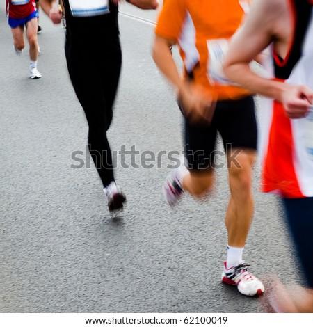 People running in city marathon - stock photo