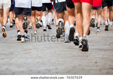 People running in city marathon