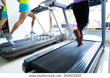 People running on a treadmill - stock photo