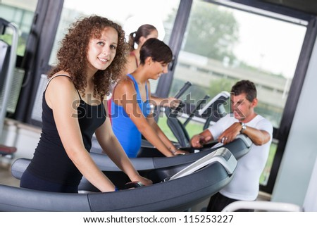 People Running on Treadmill in the Gym