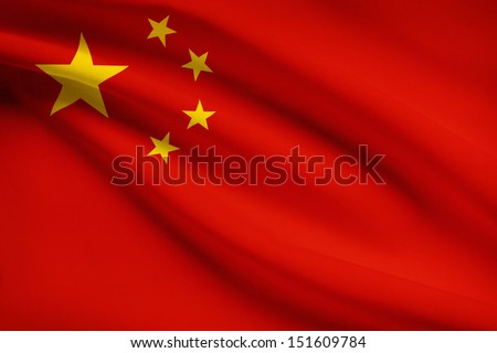 People's Republic of China flag blowing in the wind. Part of a series. - stock photo