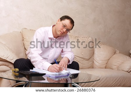 people series: young serious man sign document