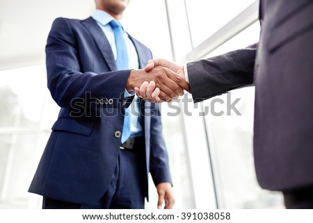 People shaking hands - stock photo