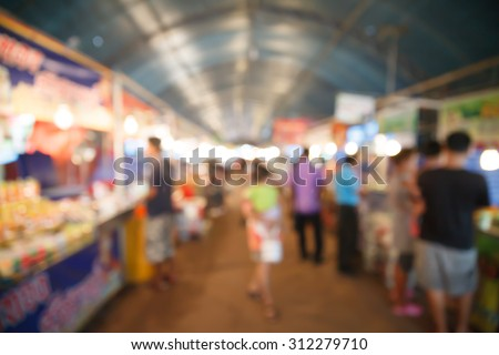 people shopping at market and blurred background - stock photo
