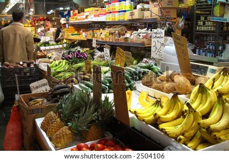 people shopping at the farmers market - stock photo