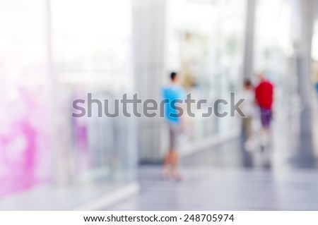 People shopping in department store. blur background.  - stock photo