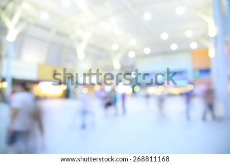 People shopping in department store. Defocused blur background with Bokeh - stock photo