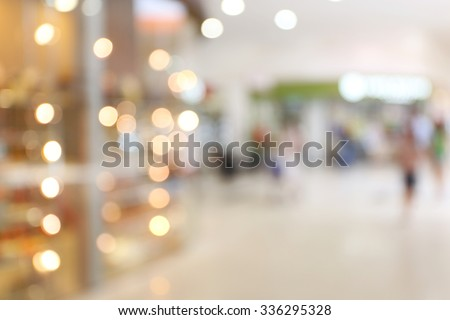 People shopping in store, blurred background - stock photo