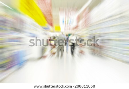 People Shopping In Supermarket. Motion blur - stock photo