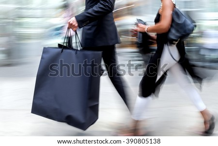 people shopping in the city in motion blur