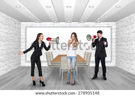 People shouting in megaphones. Office Close Ears - stock photo