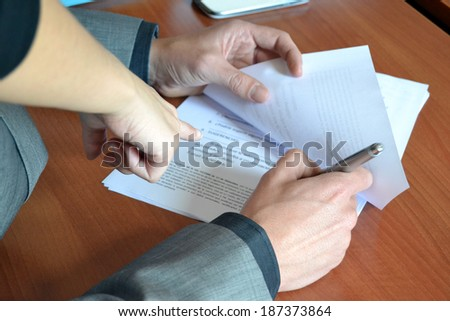 People signing contract - stock photo