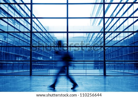 people silhouette in hall of office building - stock photo