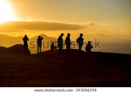 People silhouette on the mountain with beautiful view on Cofete beach on Fuerteventura island on the sunset in Spain