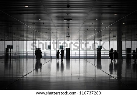 People silhouettes at the underground tunnel - stock photo