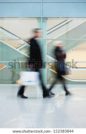 people silhouettes in motion blur