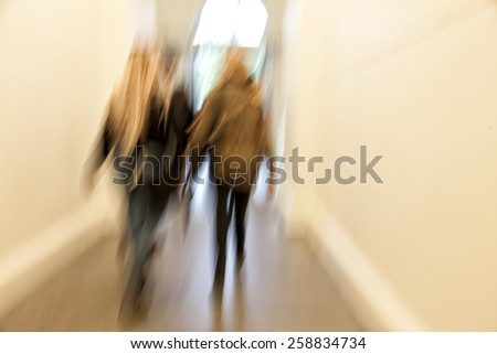 People silhouettes in motion blur, zoom effect - stock photo