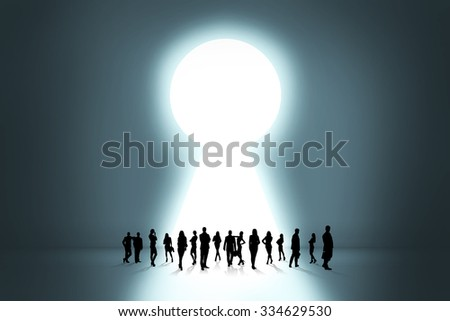 People silhouettes stand on the big keyhole exit behind